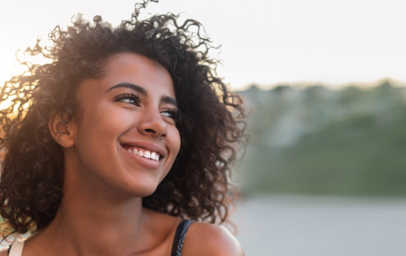 Outdoor portrait of beautiful smiling african-american woman, copy space